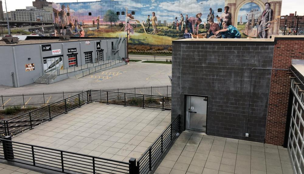 The Blatt Beer and Table's rooftop paver patio with view of downtown Omaha mural.
