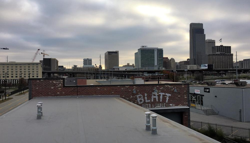 Image of the Blatt Beer and Table TPO roof with a view of the downtown Omaha Nebraska skyline.